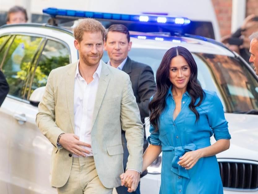 Princ Harry z ženo