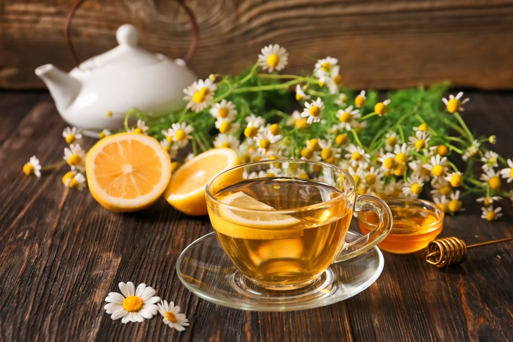 Cup,Of,Chamomile,Tea,On,Wooden,Background
