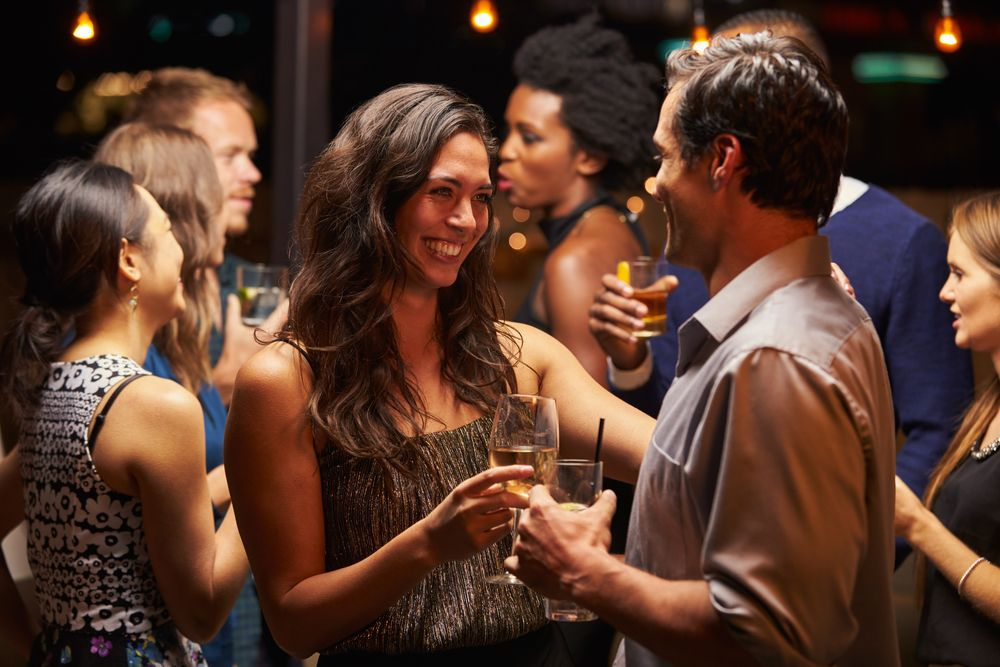 Couples,Dancing,And,Drinking,At,Evening,Party