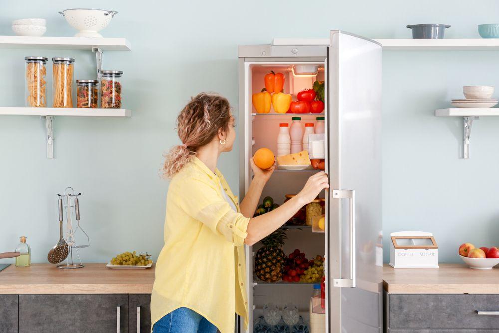 Woman,Choosing,Food,In,Modern,Fridge,At,Home