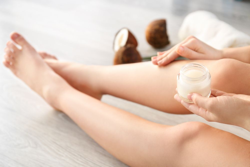 Woman,Applying,Coconut,Oil,Onto,Skin,,Closeup