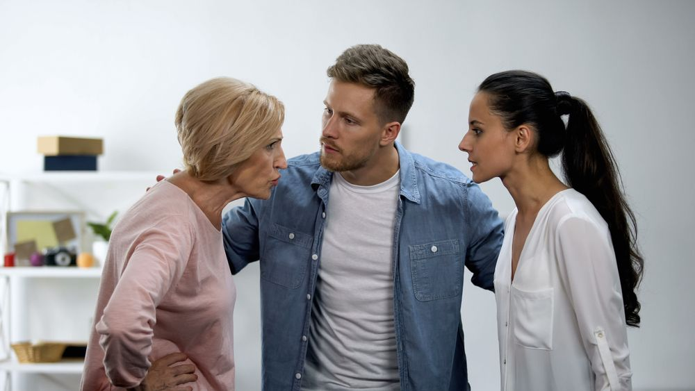 Man,Trying,To,Calm,Wife,And,Mother,Arguing,,In-law,Conflict,
